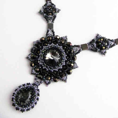 Necklace with starshaped pendant and ornate strands