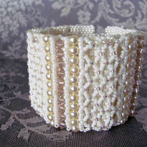 Beaded cuff of ivory seedbeads with pearls and pink bicones